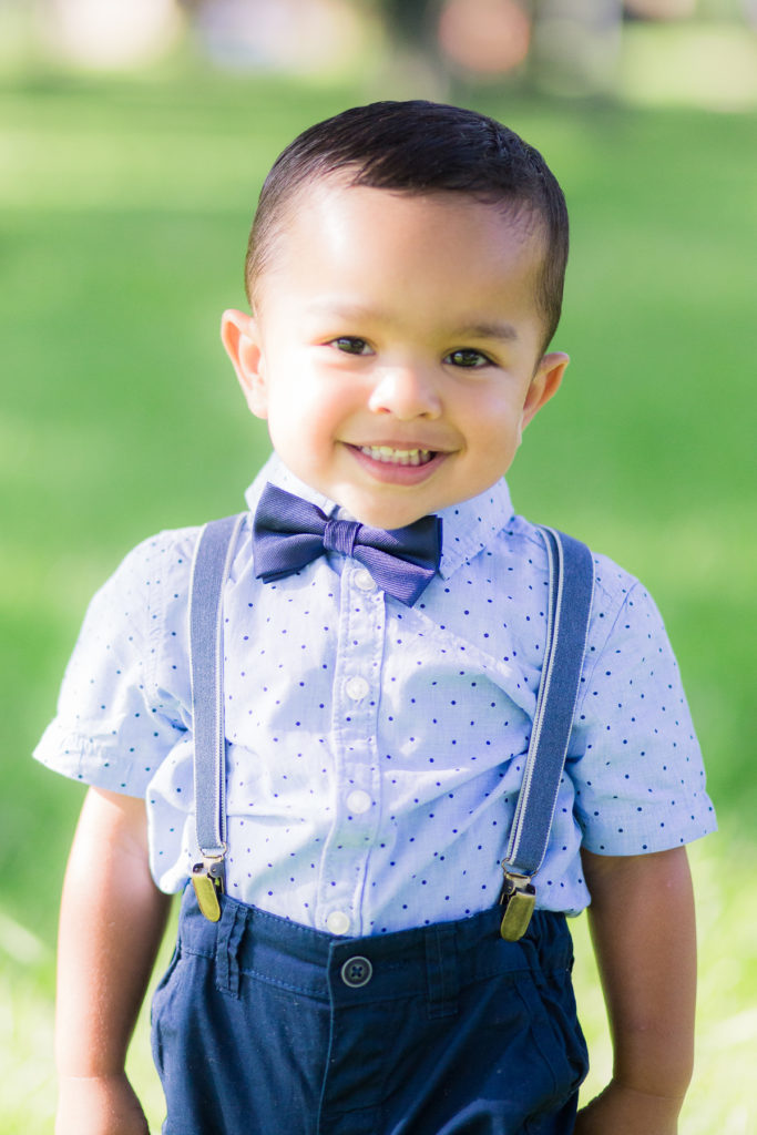 2 year old 2nd Birthday Photo Session - Our Long Life wearing bow tie and suspenders with balloon